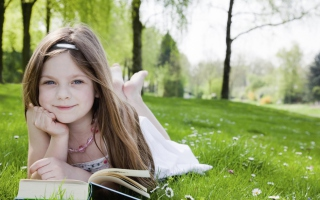 Free Cute Little Girl Reading Book In Garden Picture for Android, iPhone and iPad