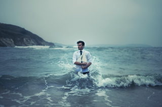Man With Ship In Hands And Ocean Waves Around Him Picture for Android, iPhone and iPad