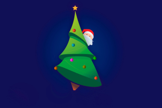 Santa Hising Behind Christmas Tree Picture for Android, iPhone and iPad