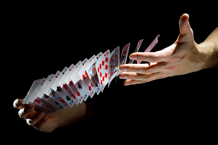 Playing cards trick wallpaper