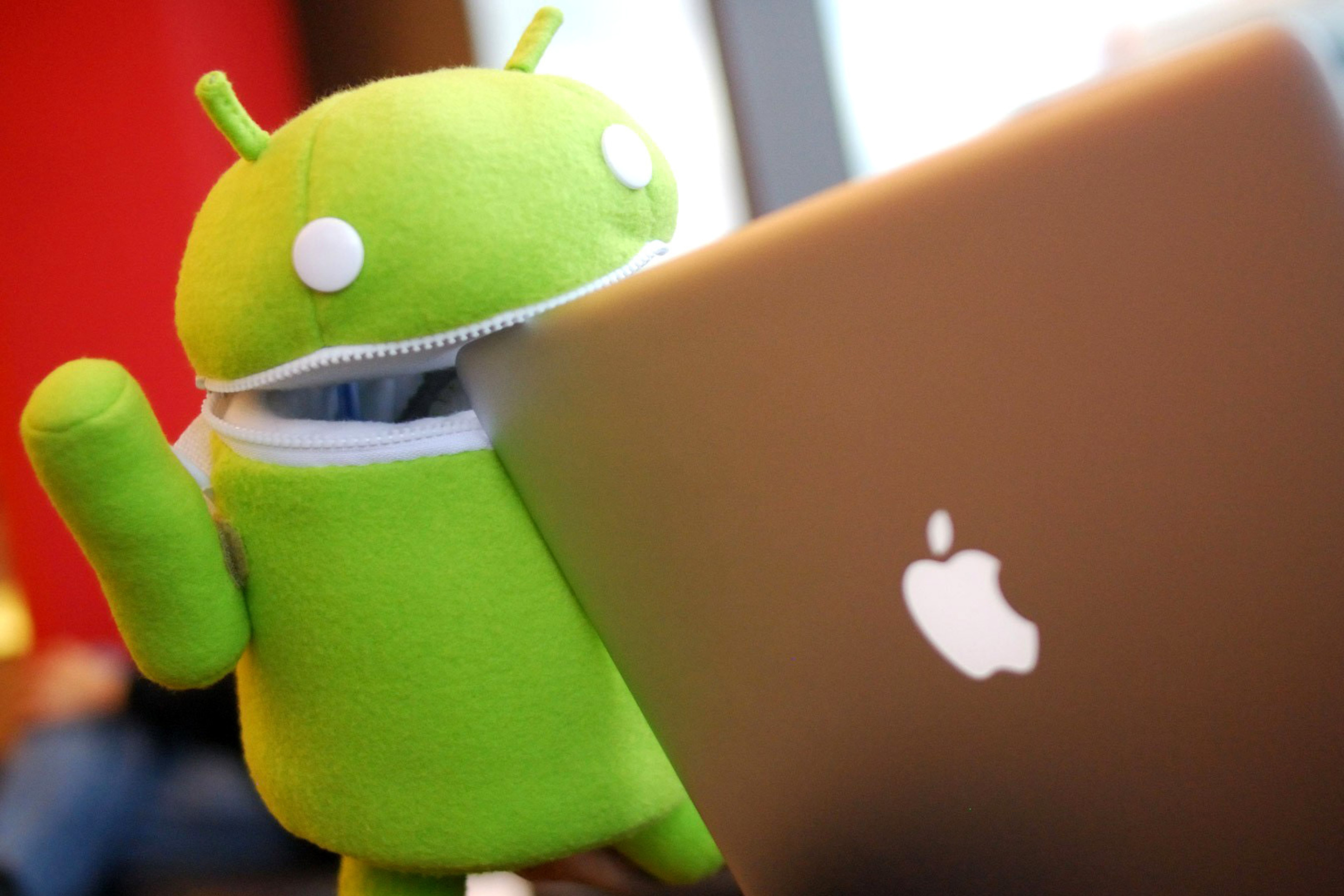 Android Robot and Apple MacBook Air Laptop wallpaper 2880x1920