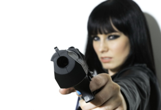 Brunette With Gun Picture for Android, iPhone and iPad