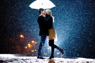 Kissing under snow Wallpaper for Android, iPhone and iPad