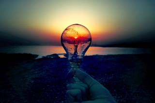 Free Red Sunset Through Bulb Picture for Android, iPhone and iPad