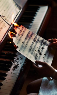 Sheet Music in Fire wallpaper 240x400