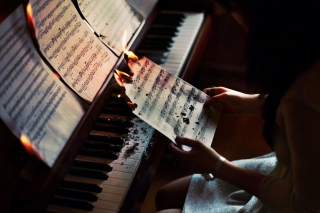 Sheet Music in Fire Background for Android, iPhone and iPad
