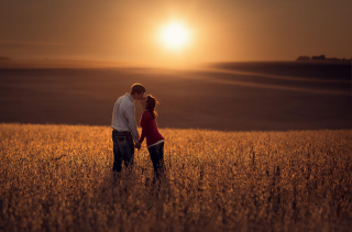 Couple Kissing In Field Wallpaper for Android, iPhone and iPad