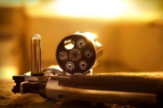 Kostenloses Revolver with Handgun Cartridges Wallpaper für Android, iPhone und iPad