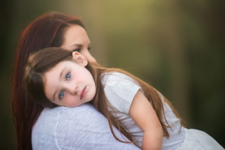 Mom And Daughter With Blue Eyes Wallpaper for Android, iPhone and iPad