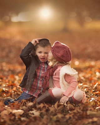 Boy and Girl in Autumn Garden Background for 640x1136