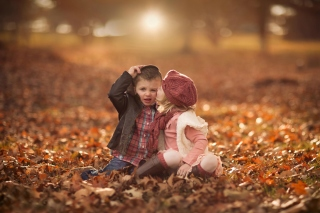 Boy and Girl in Autumn Garden Wallpaper for Android, iPhone and iPad