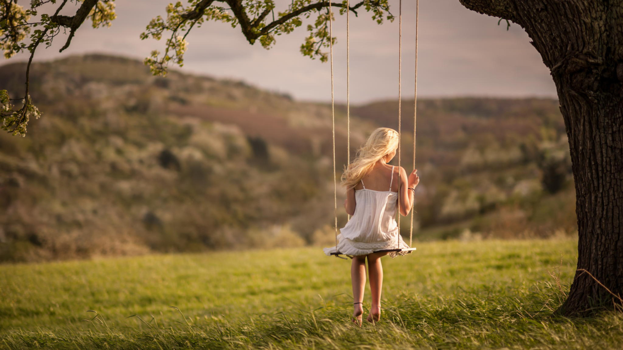 Girl On Tree Swing