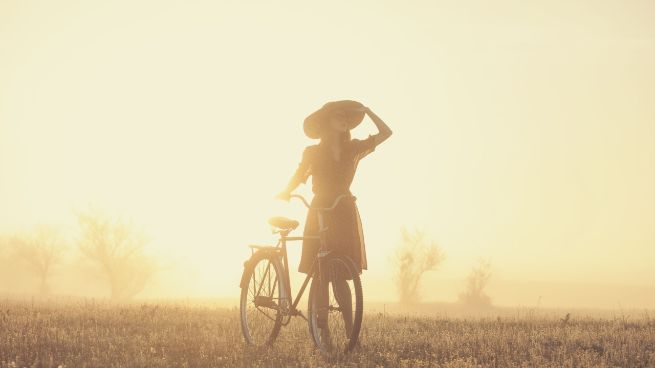 Girl And Bicycle On Misty Day