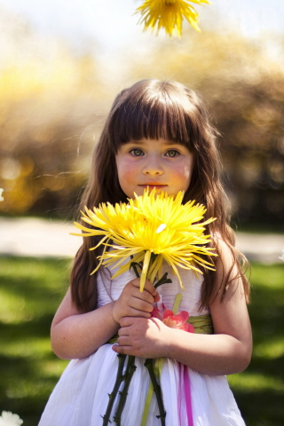 Screenshot №1 pro téma Sweet Child With Yellow Flower Bouquet 320x480