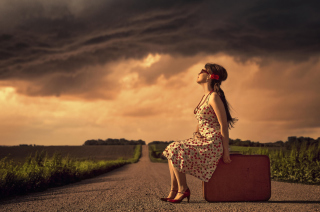 Girl Sitting On Luggage On Road Picture for Android, iPhone and iPad