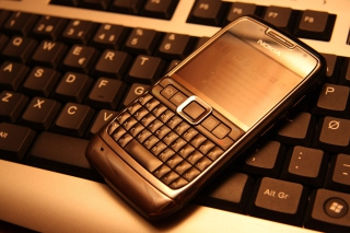 Nokia E71 on Computer Keyboard Background for Android, iPhone and iPad