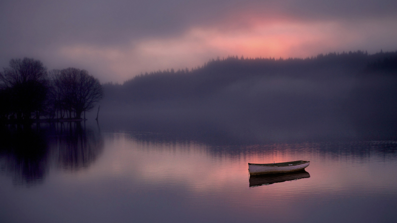 Lonely Boat And Foggy Landscape