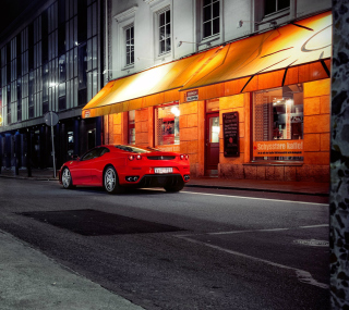 Red Ferrari In City Lights Wallpaper for iPad 3