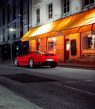 Red Ferrari In City Lights Background for Nokia Asha 503
