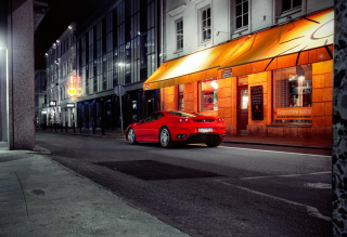 Red Ferrari In City Lights Background for Android 1440x1280