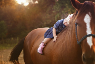 Blonde Child On Horse Background for Android, iPhone and iPad