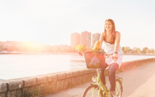 Girl On Bicycle In Sun Lights Background for Android, iPhone and iPad
