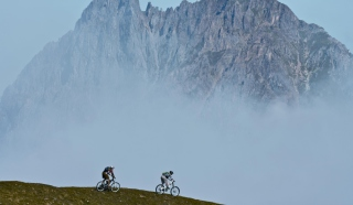 Bicycle Riding In Alps Mountains Background for Android, iPhone and iPad