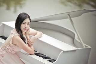 Kostenloses Beautiful Pianist Girl Wallpaper für Android, iPhone und iPad