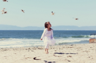 Little Girl And Seagulls On Beach Background for Android, iPhone and iPad