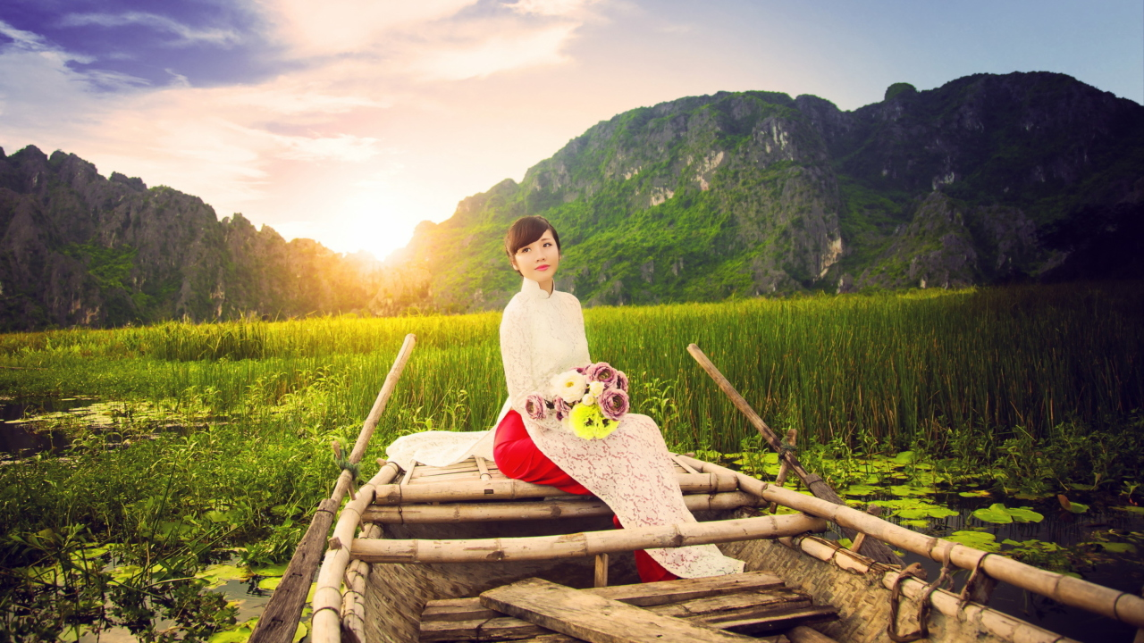 Beautiful Asian Girl With Flowers Bouquet Sitting In Boat