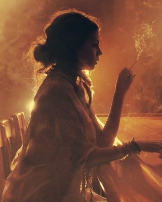 Sad girl with cigarette in bar Background for 640x1136