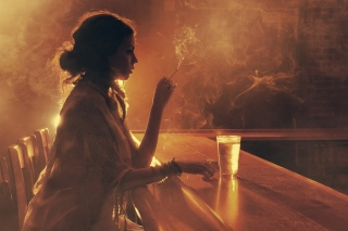 Sad girl with cigarette in bar Background for 1920x1080
