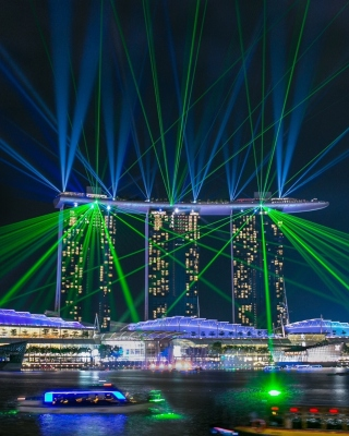 Laser show near Marina Bay Sands Hotel in Singapore Background for Nokia Asha 306