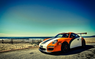 Orange Porsche 997 Picture for Nokia Asha 201