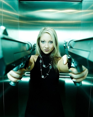 Girl with guns as gangster Background for 240x320