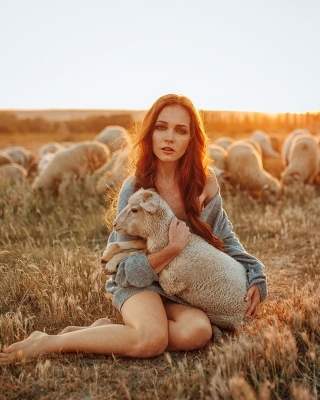 Girl with Sheep Wallpaper for Nokia 5800 XpressMusic