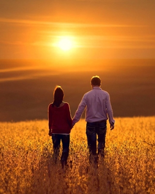 Couple at sunset sfondi gratuiti per iPhone 6 Plus