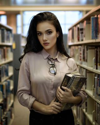 Free Girl with books in library Picture for 640x1136