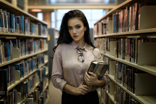 Girl with books in library Background for Android, iPhone and iPad