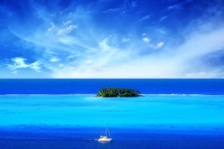 Green Island In Middle Of Blue Ocean And White Boat papel de parede para celular