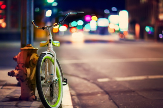 Green Bicycle In City Lights sfondi gratuiti per cellulari Android, iPhone, iPad e desktop