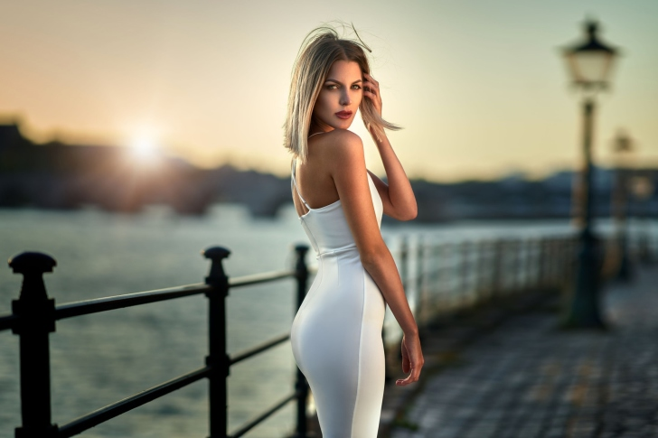Blonde in evening near sea wallpaper