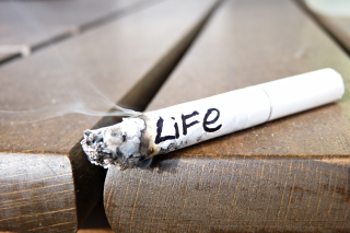 Life burns with cigarette Background for Motorola DROID