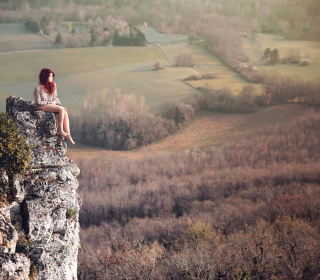 Redhead Girl Sitting On Rock sfondi gratuiti per iPad mini