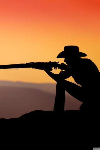 Screenshot №1 pro téma Cowboy Shooting In The Sunset 320x480