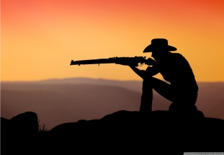 Kostenloses Cowboy Shooting In The Sunset Wallpaper für Samsung Galaxy S5
