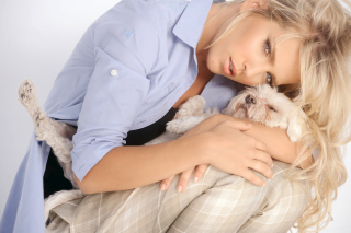 Free Pretty Blonde Hugging Her Fluffy Puppy Picture for Android, iPhone and iPad