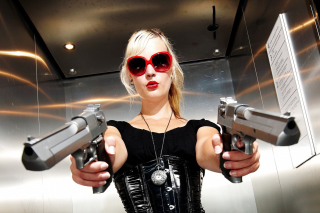 Blonde girl with pistols Background for Android, iPhone and iPad