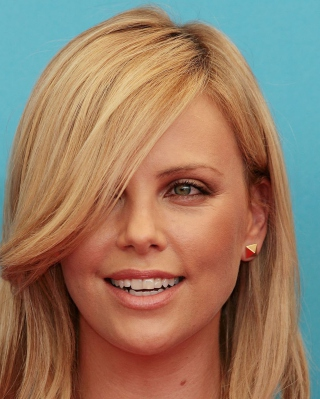Free Charlize Theron Smile Picture for Nokia X2-02