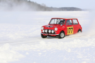 Red Mini In Snow Background for Android, iPhone and iPad